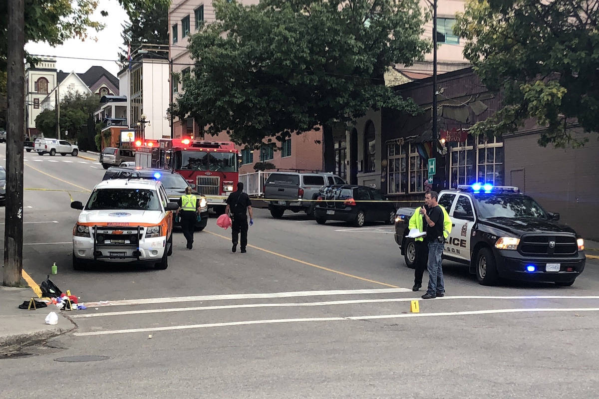 The crime scene after the victims had been taken to hospital. Photo: Tyler Harper                                Police on scene of a stabbing in downtown Nelson, B.C. on Sept. 19, 2019. (Tyler Harper/Nelson Star)