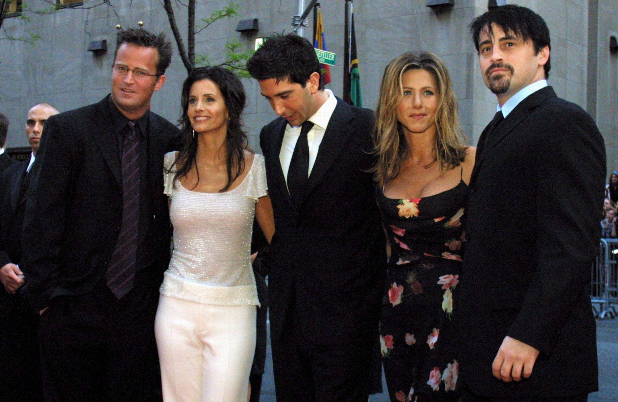 """In this May 5, 2002 file photo, the cast members, Matthew Perry, from left, Courteney Cox Arquettte, David Schwimmer, Jennifer Aniston and Matt LeBlanc of the television show """"Friends,"""" arrive at New York's Rockefeller Center for NBC's 75th Anniversary event. (AP Photo/Tina Fineberg, File)"""
