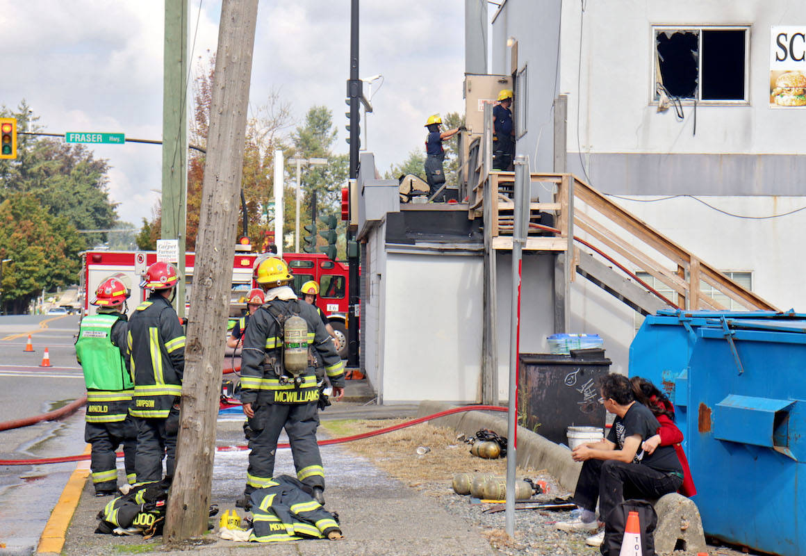 More than a dozen Langley Township firefighters worked to contain a fire that sparked in one of the Alder Inn's second-floor rooms on Friday afternoon. The old building – which was constructed in 1957 – has no fire protection system. (Sarah Grochowski photo)