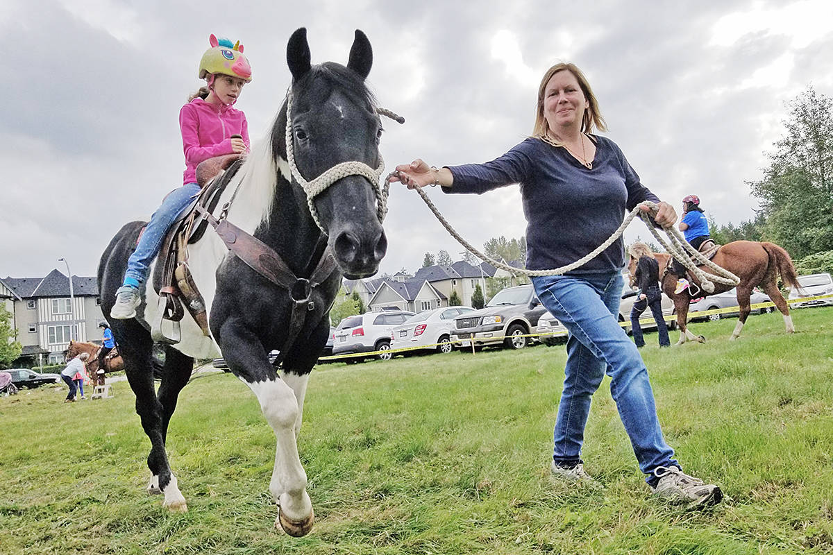 There was a pony ride. Volunteers with the Thanksgiving food drive were treated to a mini carnival. (Dan Ferguson/Langley Advance Times)