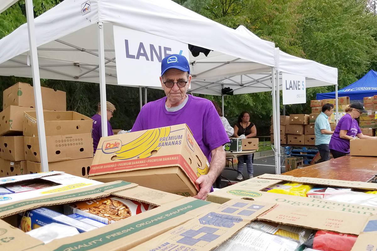 Russ Moore from Port Coquitlam was one of hundreds of volunteers who worked to make the annual Thanksgiving food drive a success. (Dan Ferguson/Langley Advance Times)