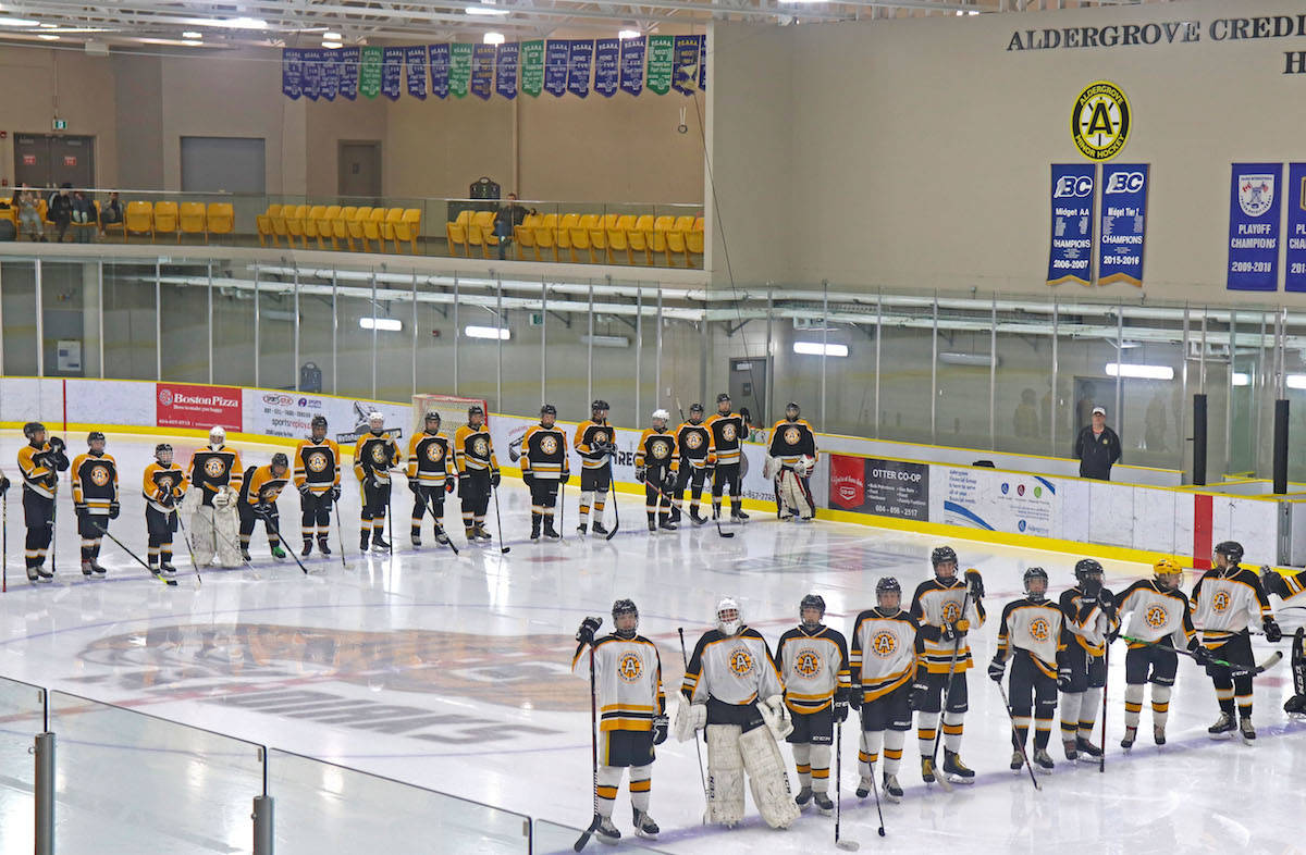 AMHA midget team's C1 and C2 players also wore their jerseys, and full gear, as they skated onto the rink and lined up in tribute to Coleton near the end of the dedication. It was a moment of silence for the family, most of who were in tears. (Sarah Grochowski photo)