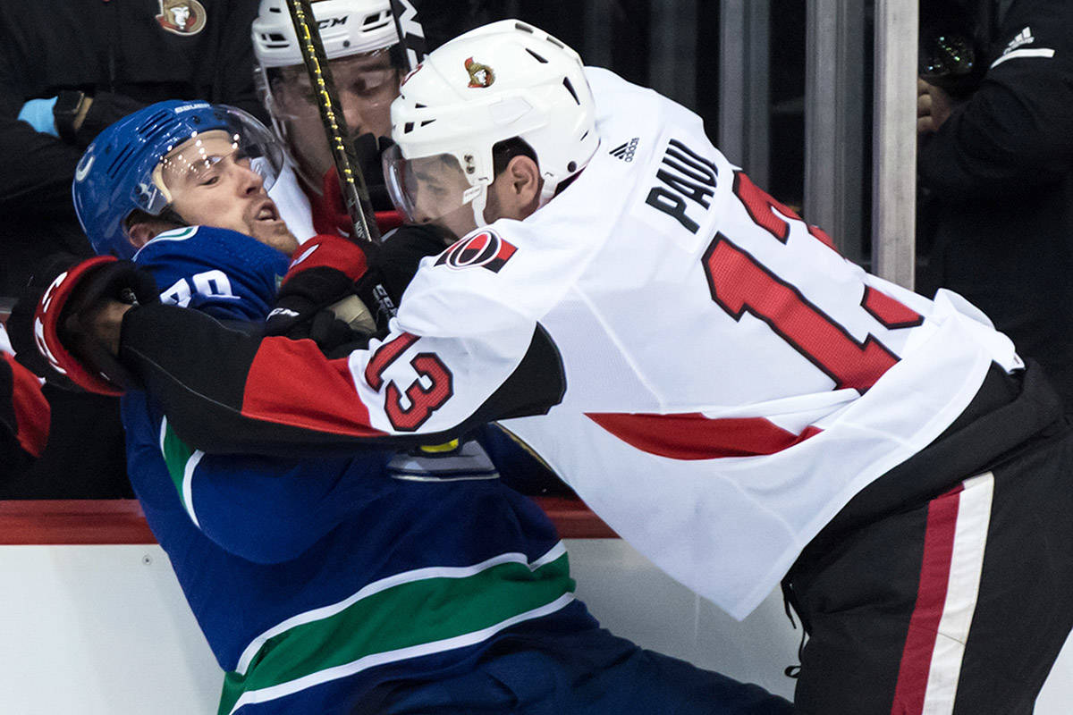 Ottawa Senators' Nick Paul, right, checks Vancouver Canucks' Tanner Pearson during second period NHL pre-season hockey action in Abbotsford, B.C., on Monday, Sept. 23, 2019. THE CANADIAN PRESS/Darryl Dyck