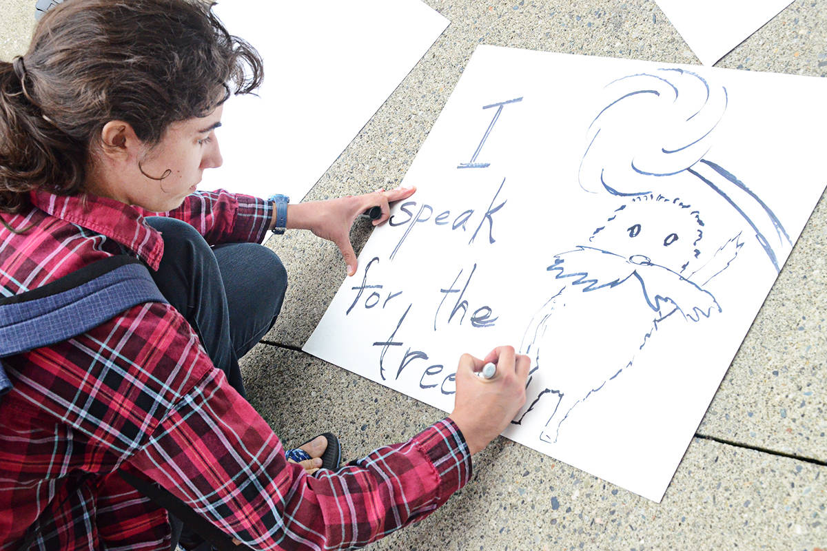 Aurora Sarchet, a Trinity Western University student, made a sign for a Climate Strike protest on Friday, Sept. 20 at Langley Township Civic Facility. The Langley School District released a statement that it would allow its students to be absent for Sept. 27 events with parental permission. (Matthew Claxton/Langley Advance Times)