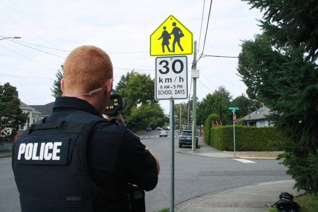 FILE - Const. Devin Fidler points a Dragoneye speed reader at cars driving in Victoria ahead of back-to-school week.(Travis Paterson/News Staff)
