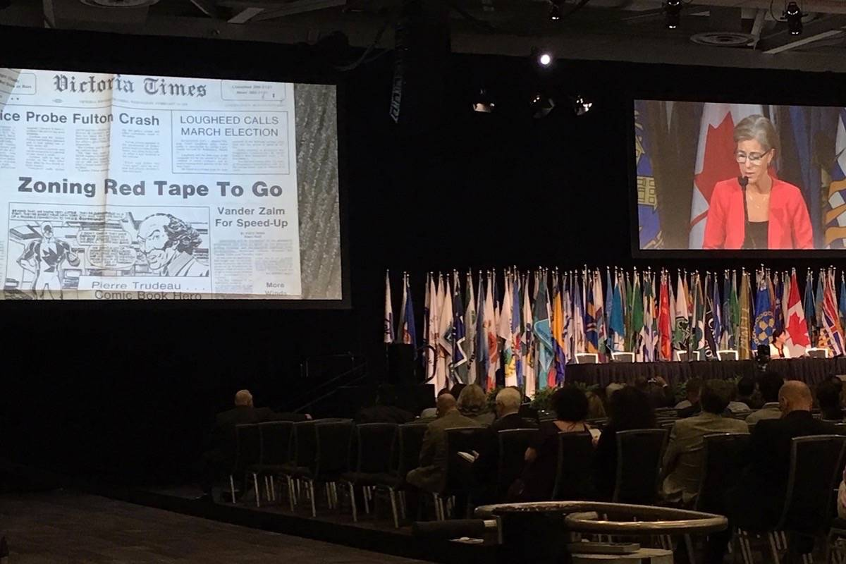 B.C. Municipal Affairs Minister Selina Robinson shows 40-year-old front page where then-minister Bill Vander Zalm promises to cut red tape from housing approval process, UBCM convention, Vancouver, Sept. 25, 2019. (Tom Fletcher/Black Press)
