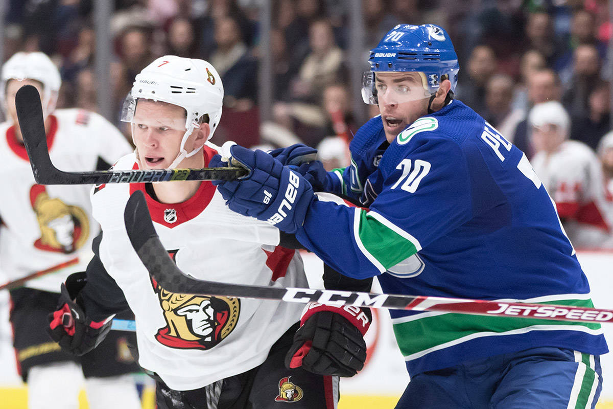 Vancouver Canucks left wing Tanner Pearson (70) checks Ottawa Senators left wing Brady Tkachuk (7) during the second period of a pre-season NHL hockey game in Vancouver, on Wednesday September 25, 2019. THE CANADIAN PRESS/Darryl Dyck