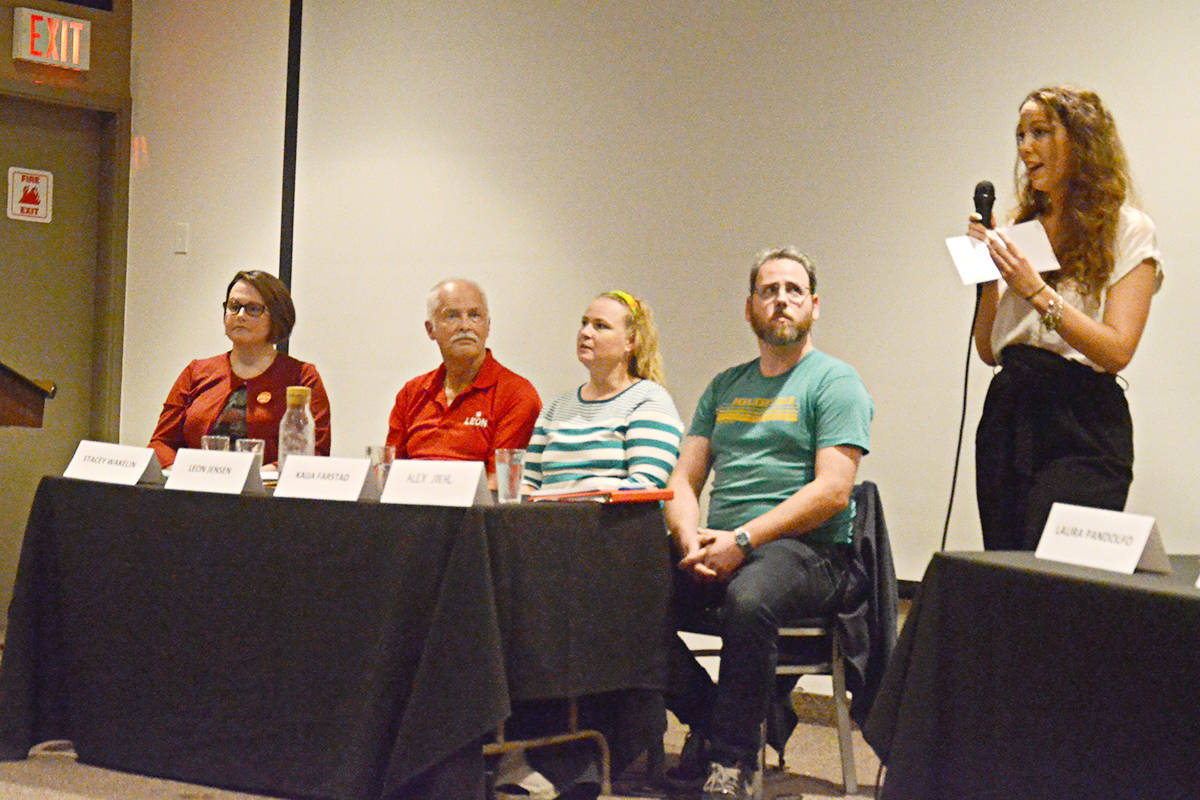 The president of the Trinity Western Environmental Club, Delia Anderson, right, introduced four candidates – from left, Stacey Wakelin, Leon Jensen, Kaija Farstad, and Alex Joehl at Thursday's debate. (Matthew Claxton/Langley Advance Times)