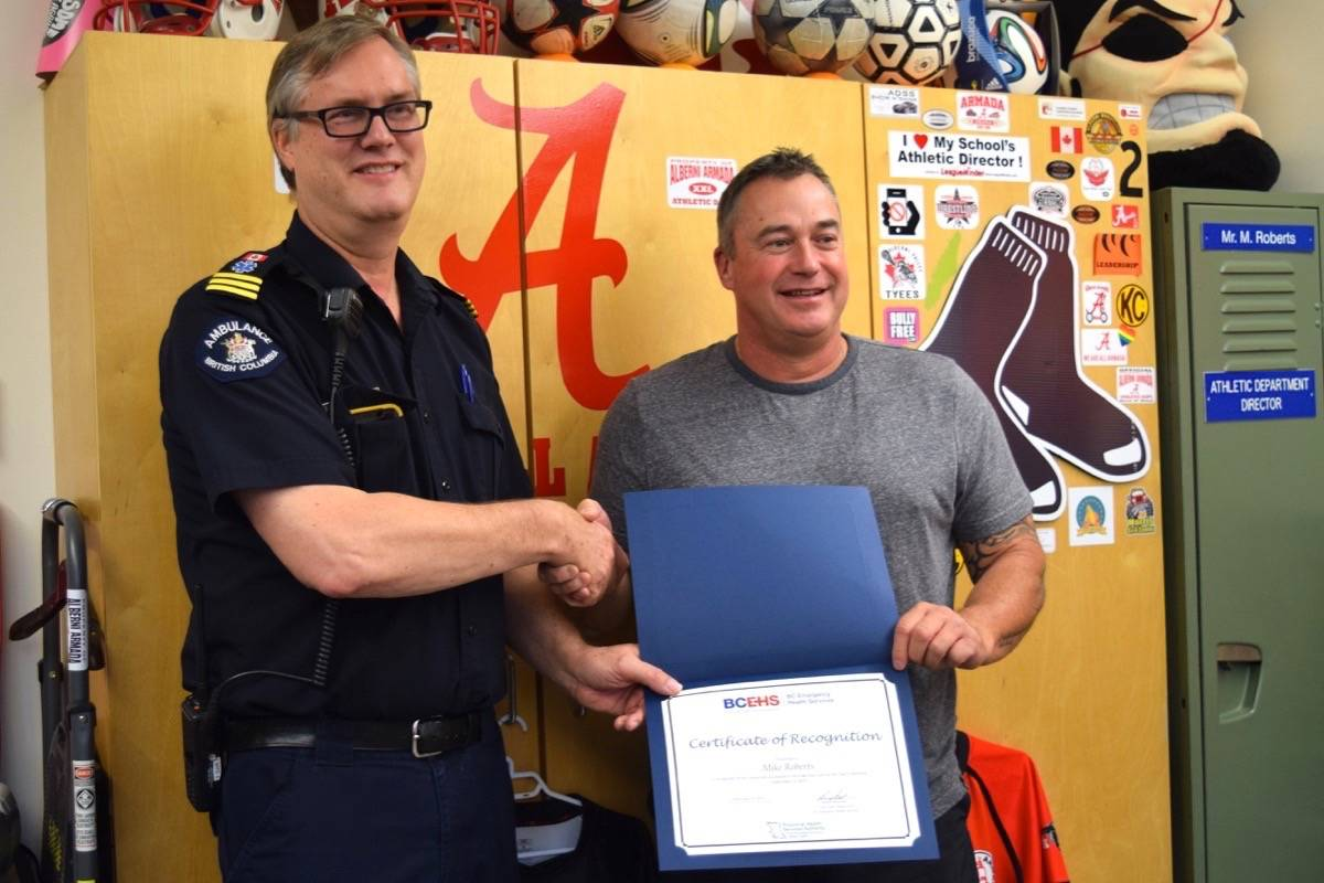 Bruce Patterson (left) presents ADSS teacher Mike Roberts with a certificate of recognition on Tuesday, Sept. 24. ELENA RARDON PHOTO