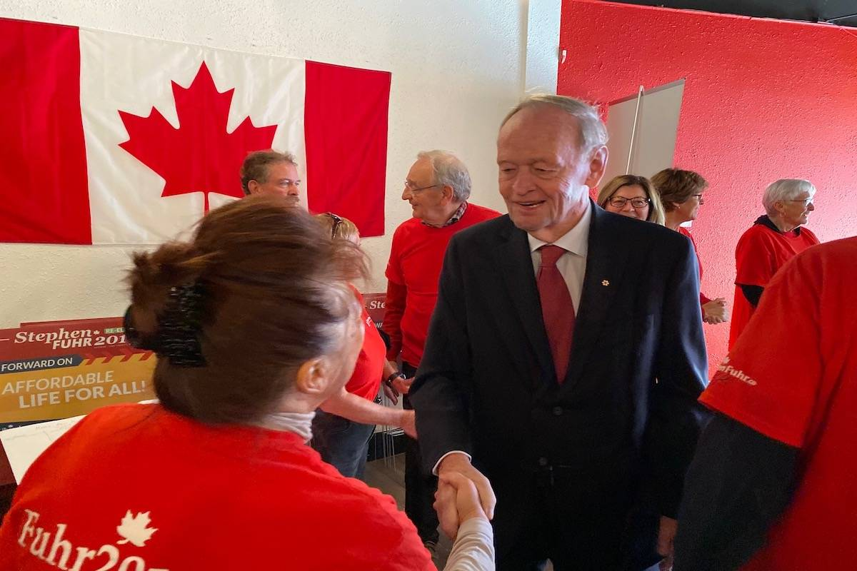 Former Canadian prime minister Jean Chretien was seen shaking hands with Liberal supporters at Stephen Fuhr's candidate office in Kelowna on Friday. (Alistair Waters - Kelowna Capital News)