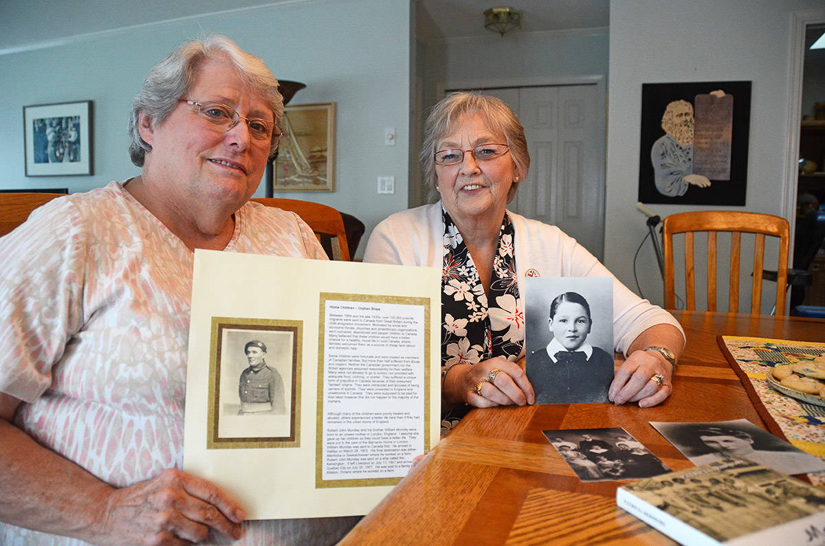 Descendants of British Home Children, Shirley Daily (left) and Carol Bateman show photos and talk about this little-known period in Canadian history. (Paul Henderson/ The Progress)
