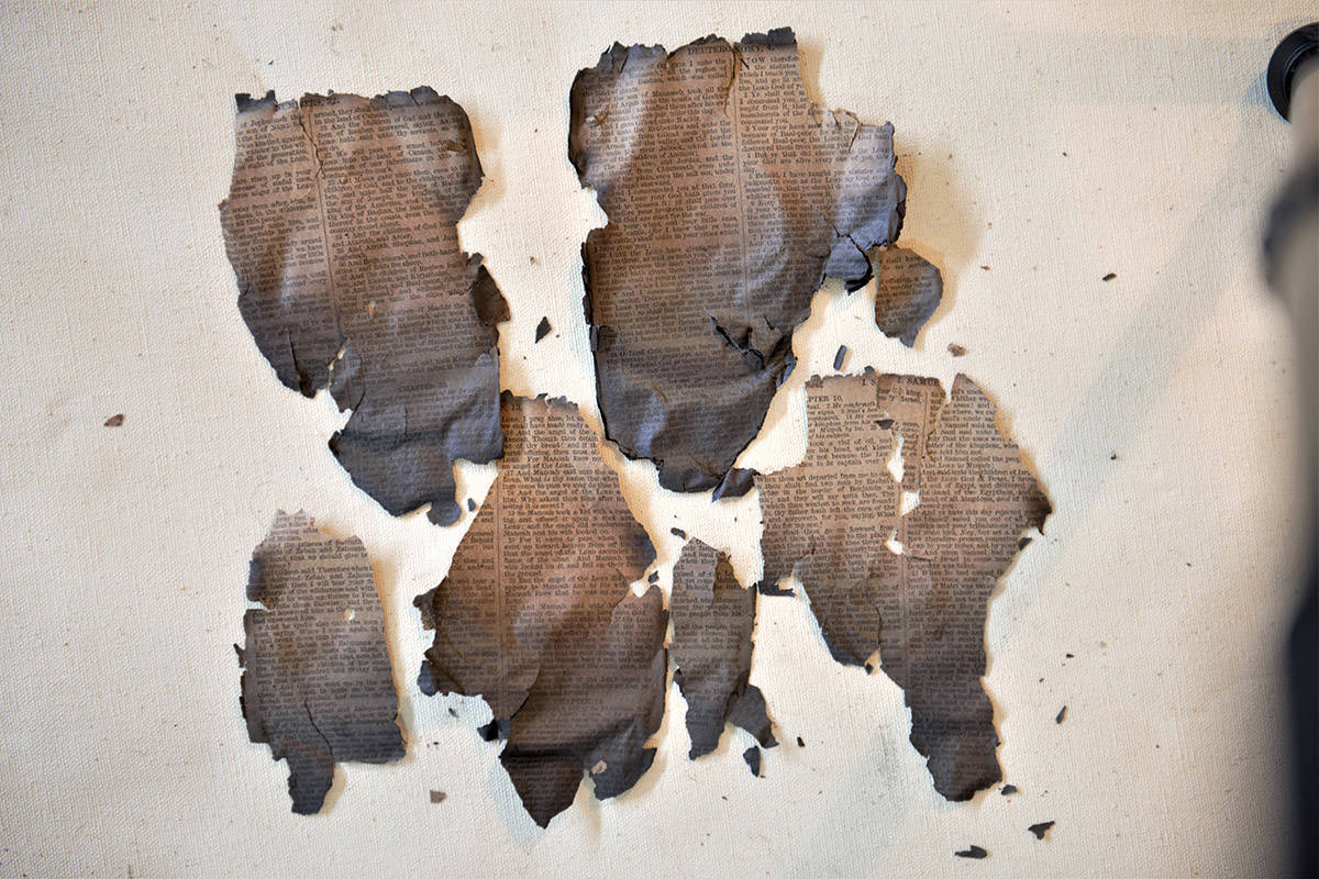 Hope photographer Ray Daws was able to salvage a few charred pages of a Bible from the site of a burned church in Quilchena. (Ray Daws photo)