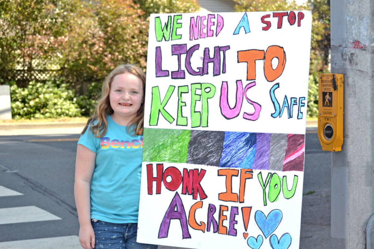 Mya Grainger, a ten-year-old student of Shortreed Elementary waited outside at the crosswalk on Friday, hoping to raise awareness about the unsafe convergence at 272 Street and 28 Avenue. (Sarah Grochowski photo)