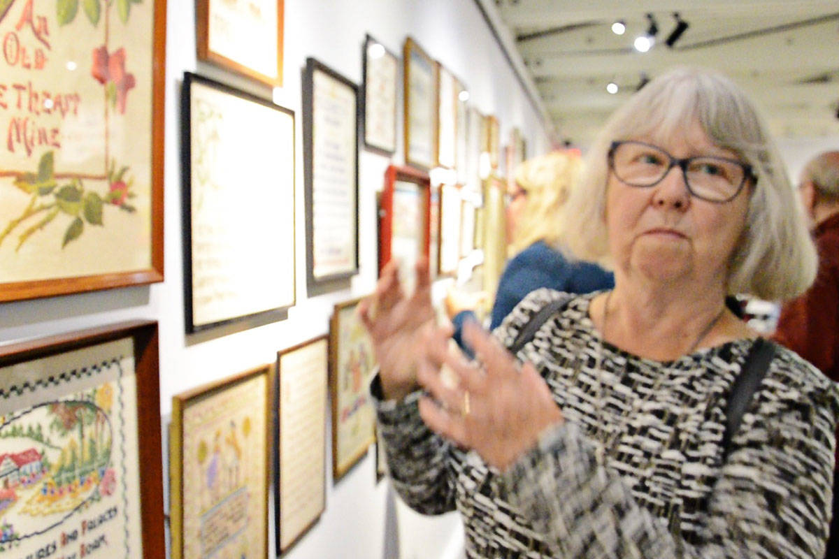 Samplers collected by Janet Copley are part of the new exhibit at the Langley Centennial Museum. (Heather Colpitts/Langley Advance Times)