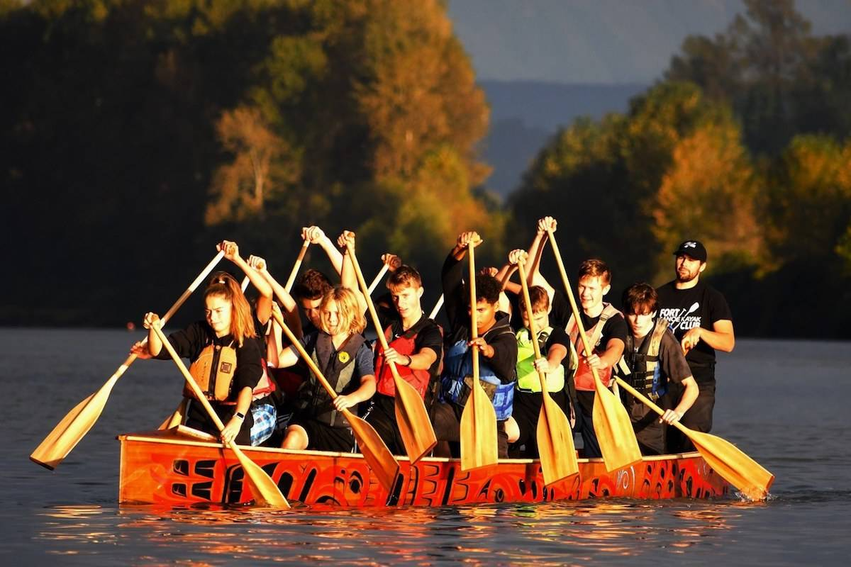 After the blessing, the canoe was hauled down to the water by club athletes and taken on its first voyage atop the Fraser River. (Special to the Aldergrove Star)