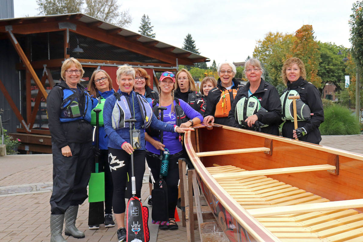A flotilla of club rowers and paddlers rushed up to accompany the canoe on its first voyage along the Fraser River. (Sarah Grochowski photo)
