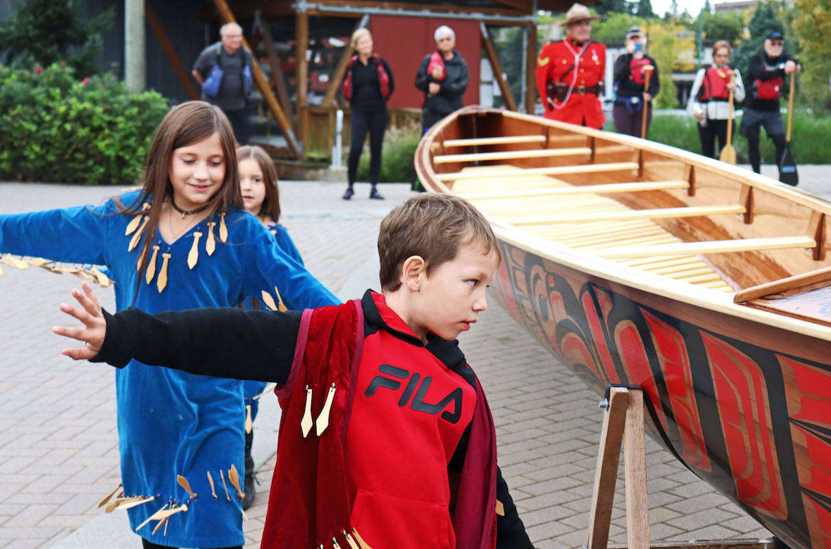 Michael Gabriel and Dennis Leon from the Kwantlen nation blessed the canoe in a traditional ceremony, and led members and youth from the clan to dance and brush branches of purification over the boat. (Sarah Grochowski photo)