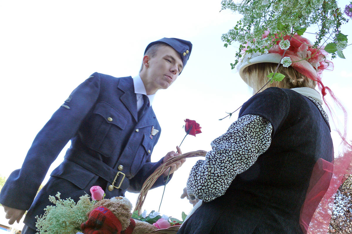 Russ Bowling (Andrew Keilbart) buys a flower for his bride on the platform of the CN Rail station in Fort Langley. (Dan Ferguson/Langley Advance Times)