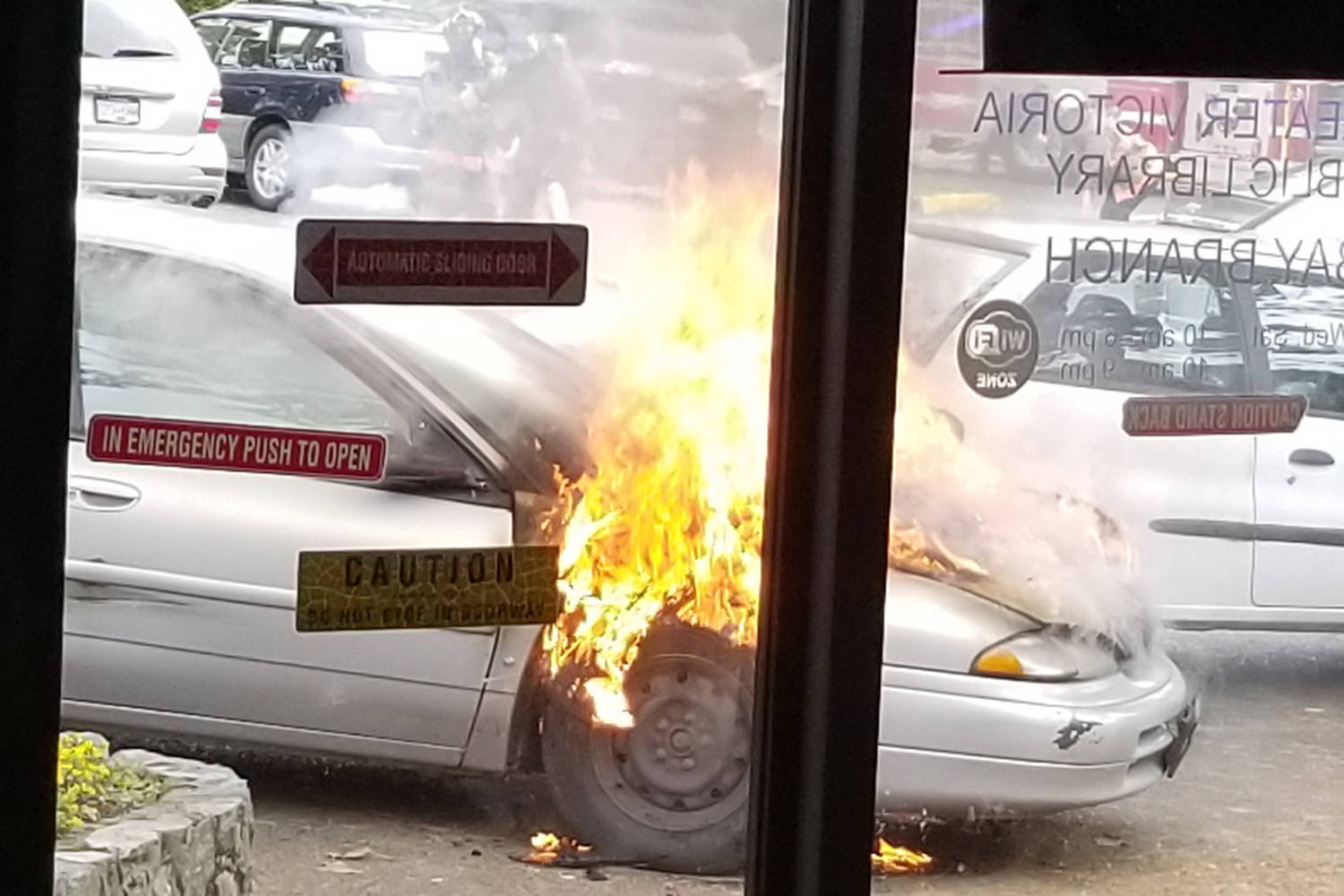 A couple pulled in briefly to the Oak Bay Library to drop off books Wednesday morning when their car caught on fire. The engine, dash, panels, windshield and tires either melted, burned or cracked under the stress of the heat. (Peter Gray Photo)