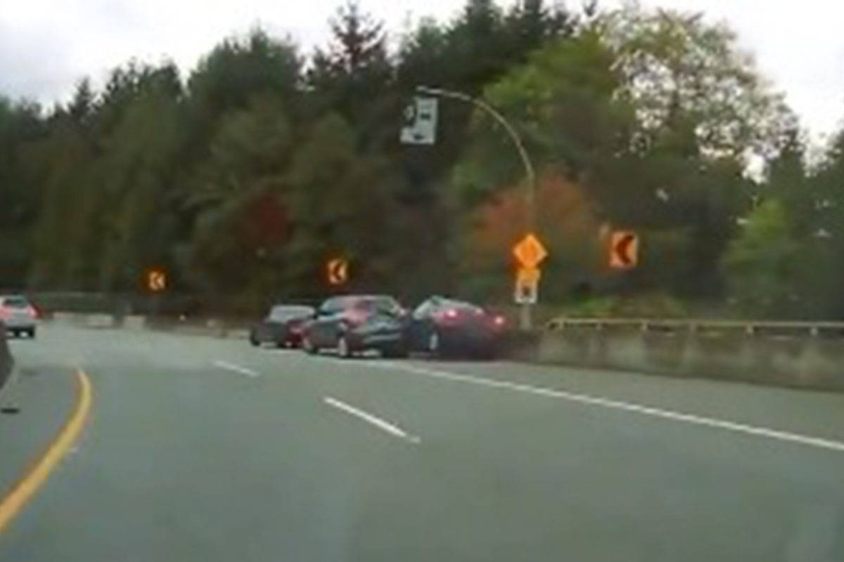 A police officer was struck on Sept. 23, 2019 along the McGill Street on-ramp to Highway 1, near the Second Narrows Bridge, while writing a distracted driving ticket for another driver. (VPD screenshot)