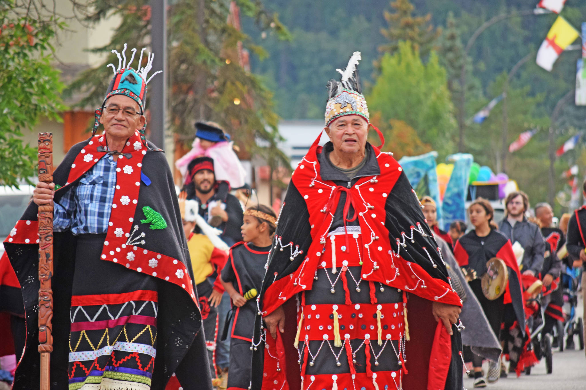 """Wet'suwet'en Hereditary Chief Na'Moks (Left) and Wet'suwet'en Hereditary leader of the Gidmt'en clan Chief Madeek (right) at the annual fall fair parade in Smithers. In an Oct. 4 press release the hereditary chiefs demanded that a cease-and-desist order be immediately issued to Coastal GasLink's pipeline project due to their claims of """"ongoing destruction of Wet'suwet'en cultural heritage and archaeological sites, and non-compliance with Wet'suwet'en and BC Provincial law."""" (Trevor Hewitt photo)"""