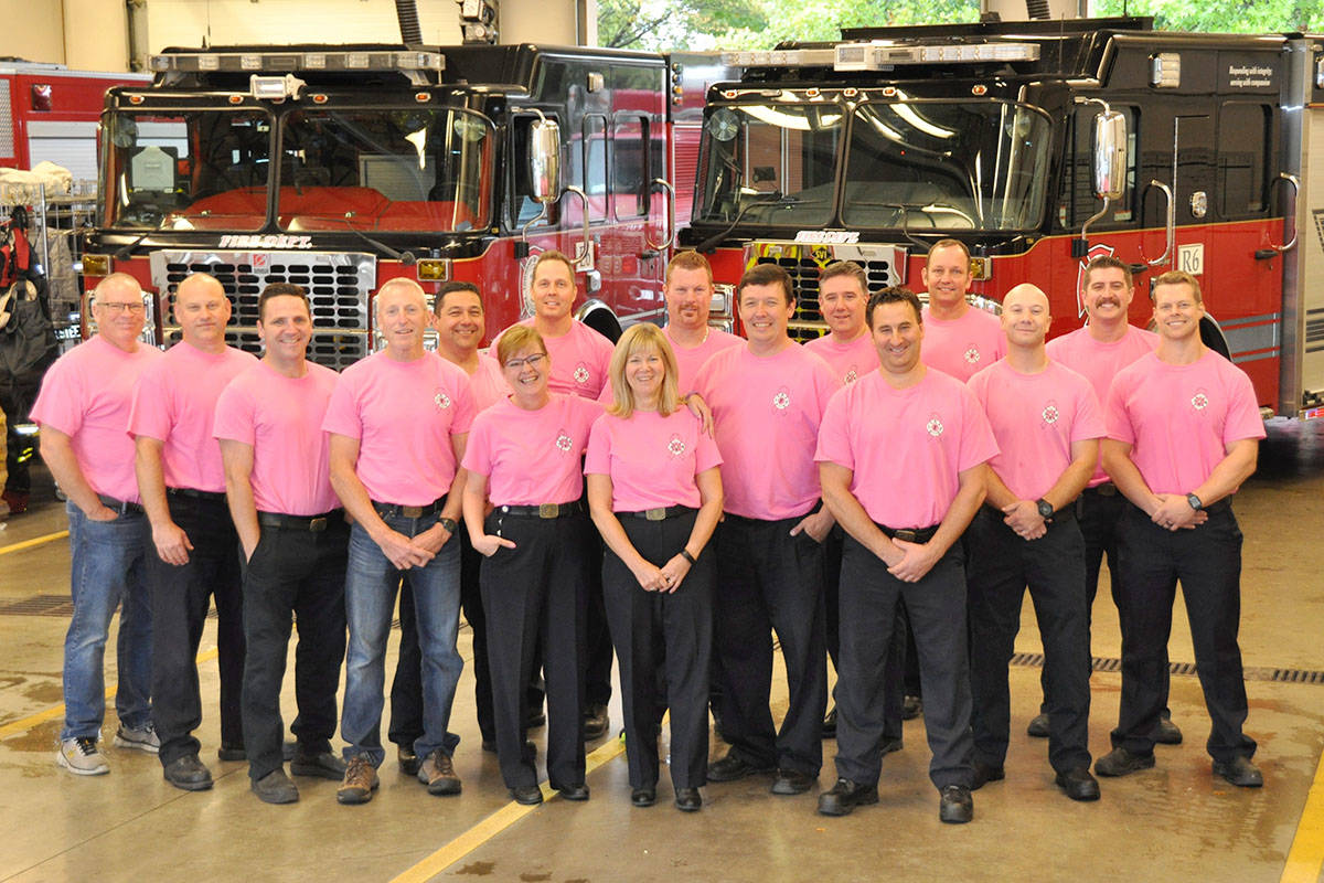 Langley Township fire crews wear pink shirts during Breast Cancer Awareness Month to support the wives of two of their members, who have been diagnosed with the disease. (Jhim Burwell/Township Fire Department)