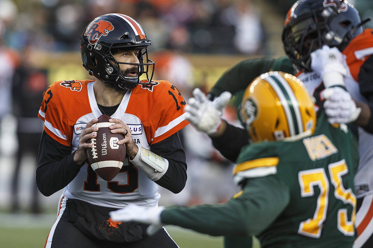 B.C. Lions quarterback Mike Reilly (13) looks to make the pass during first half CFL action against the Edmonton Eskimos, in Edmonton on Saturday, Oct. 12, 2019. THE CANADIAN PRESS/Jason Franson