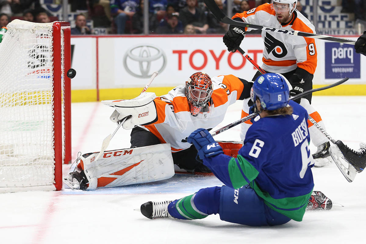 Vancouver Canucks' Brock Boeser (6) scores a goal against Philadelphia Flyers' goalie Carter Hart (79) during first period NHL hockey action in Vancouver on Saturday, Oct. 12, 2019. THE CANADIAN PRESS/Ben Nelms