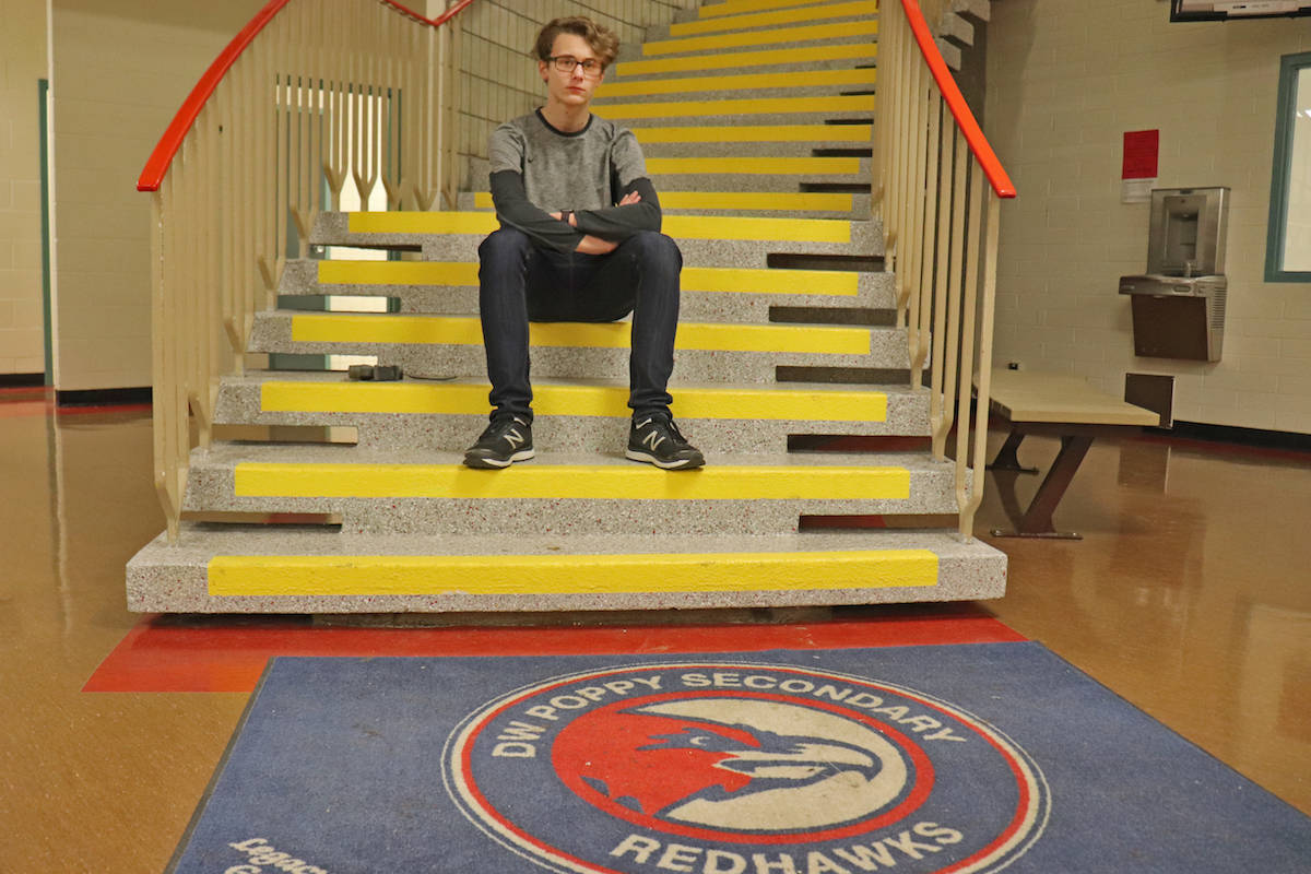 """A Grade 11 student John Barrett, followed in suit with the design of an independent, """"unbiased survey,"""" regarding middle school options for the area. (Sarah Grochowski photo)"""