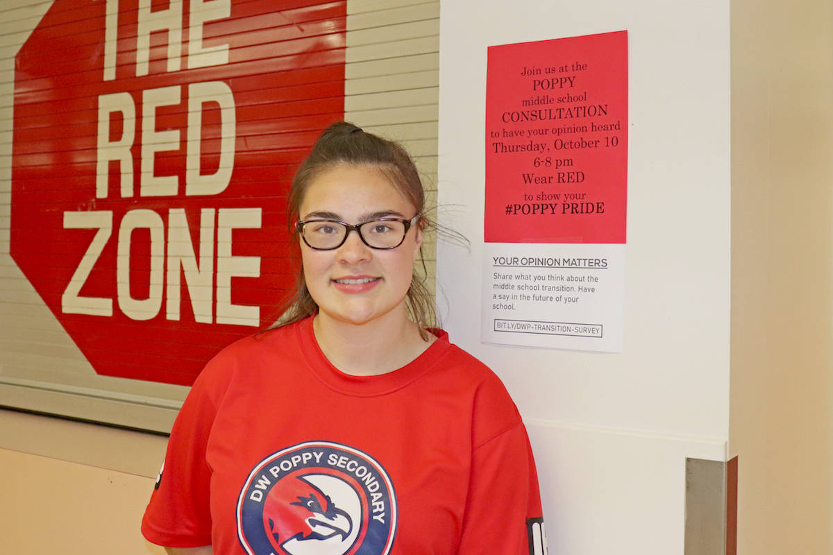 D.W. Poppy student Celeste Collie made signs encouraging others to attend the consultation meeting wearing school colours. (Sarah Grochowski photo)