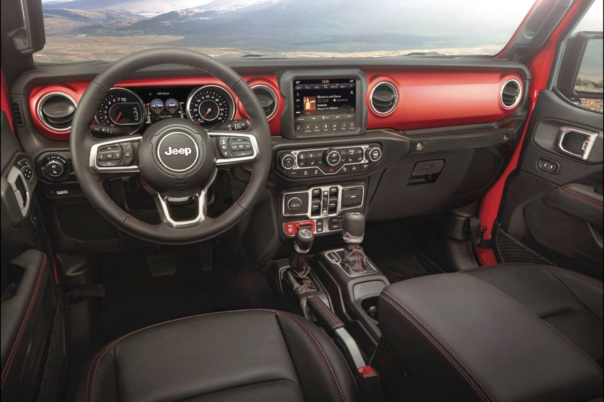 The dash layout of the Gladiator looks like that of any other Wrangler, which is to say it's a busy spot. Note that one shift lever is for the transmission and the other is for operating the transfer case for high-low gear range. Photo: FCA