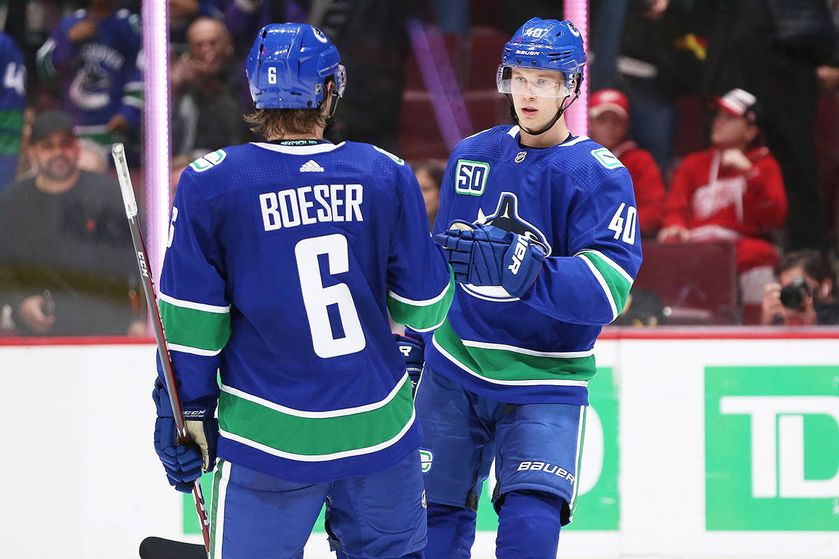 Vancouver Canucks' Elias Pettersson (40) celebrates his goal with teammate Brock Boeser (6) during second period NHL hockey action against the Detroit Red Wings, in Vancouver on Tuesday, Oct. 15, 2019. THE CANADIAN PRESS/Ben Nelms