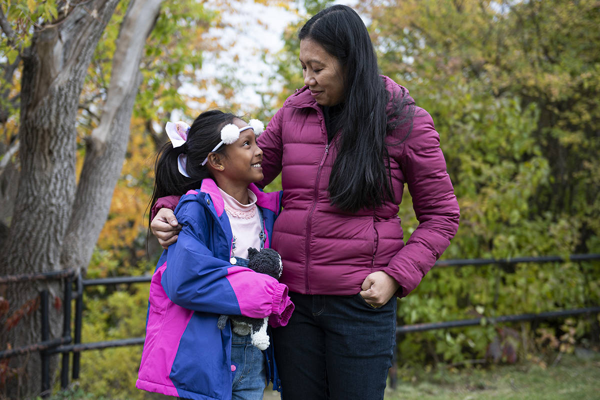 """Vanessa Mae Rodel and her daughter Keana Kellapatha, 7, are seen after a press conference on the status of the """"Snowden Refugees"""", Keana's father and siblings that remain in Hong Kong, in Ottawa, on Wednesday, Oct. 16, 2019. Rodel, who helped shelter whistleblower Edward Snowden in Hong Kong, and her daughter were granted refugee status and have lived in Montreal since March. THE CANADIAN PRESS/Justin Tang"""