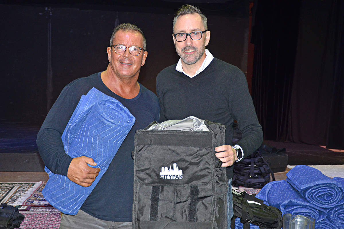 Pastor Leith White (left) and Patrick Curtis of Wolfe Auto Group handed out Citypaks and blankets to Langley's homeless this week. (Matthew Claxton/Langley Advance Times)