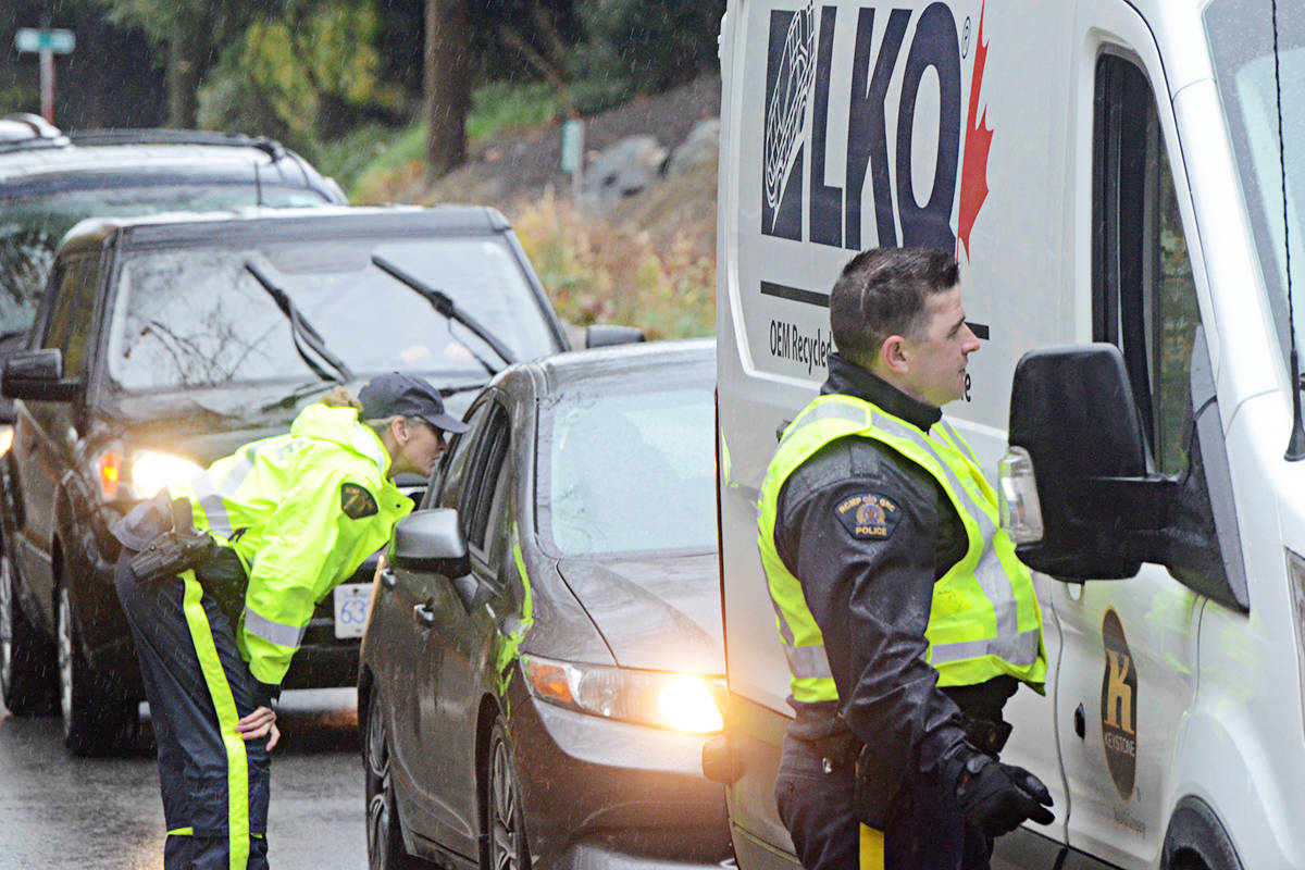 Officers talked to every driver heading south in the 4900 block of 232nd Street on Friday in an effort to find more witnesses or dashcam footage linked to a serious hit and run on Friday, Sept. 13. (Matthew Claxton/Langley Advance Times)