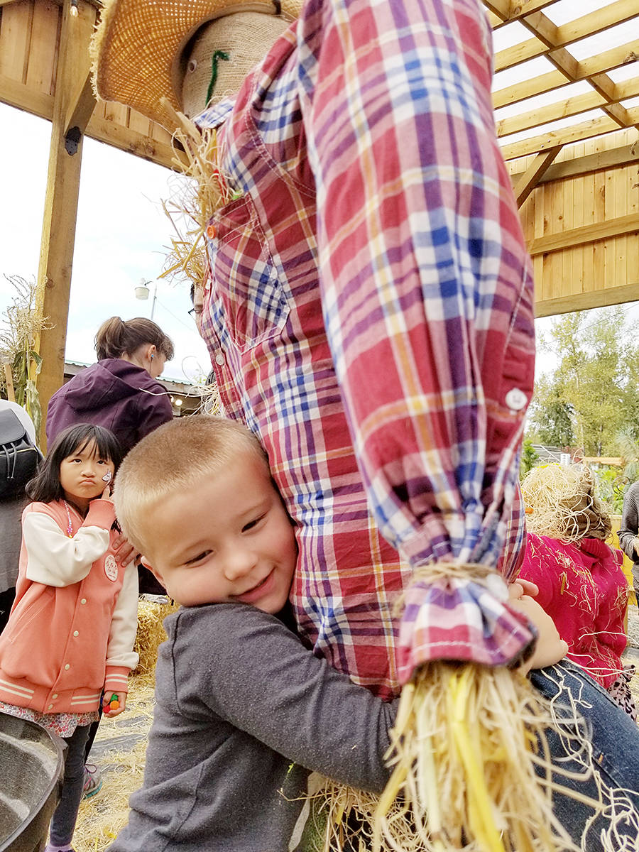 A young scarecrow builder was pleased with the results. (Dan Ferguson/Langley Advance Times)