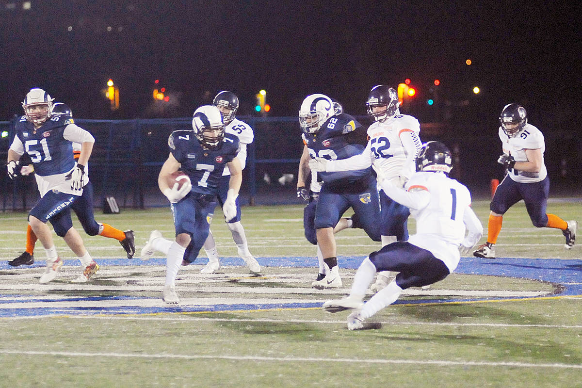 Rams offensive line cleared a path for Andrew Pocrnic as the running back set a new record for total touchdowns in a season. (Dan Ferguson/Langley Advance Times)