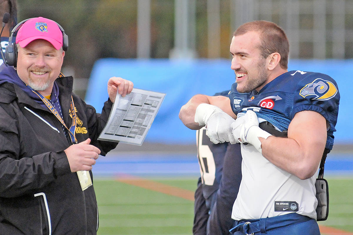 Why are these men smiling? Possibly because Langley Rams ended their regular season undefeated Saturday at McLeod Athletic Park in Langley, with No. 7, Andrew Pocrnic shattering several league records (Dan Ferguson/Langley Advance Times)