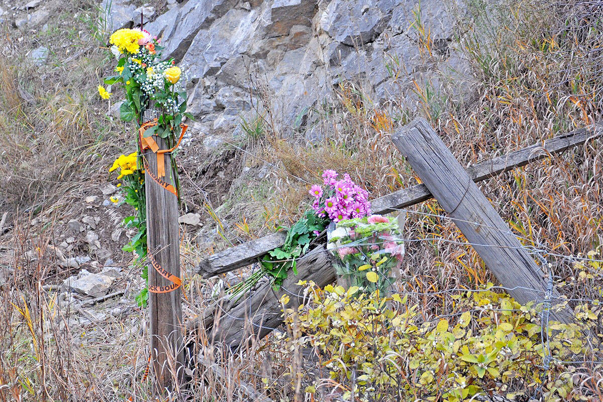 Flowers mark the scene where 17-year-old Autumn Weir was killed, on Highway 20 near Williams Lake, on Oct. 19, 2019. (Greg Sabatino/Williams Lake Tribune)