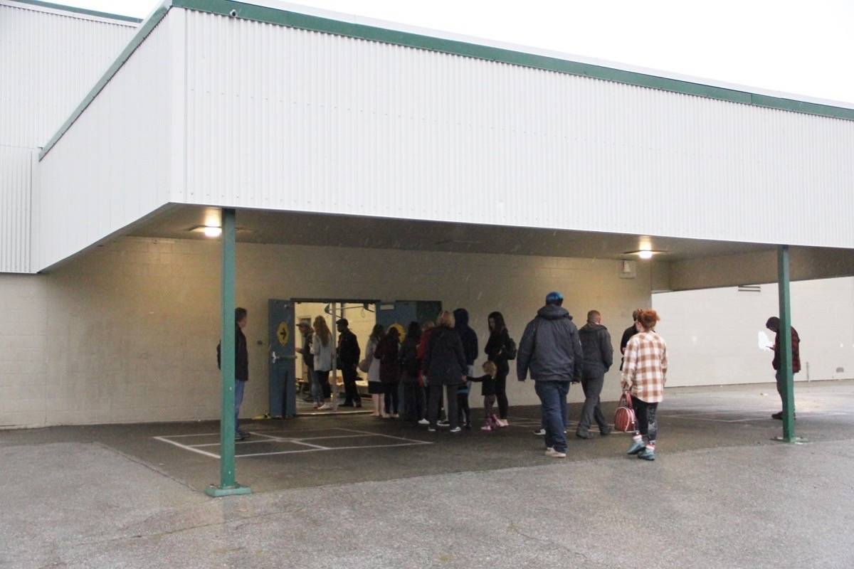 Voters line up outside the entrance to a polling station at George Greenaway Elementary School. (Photo: Malin Jordan)