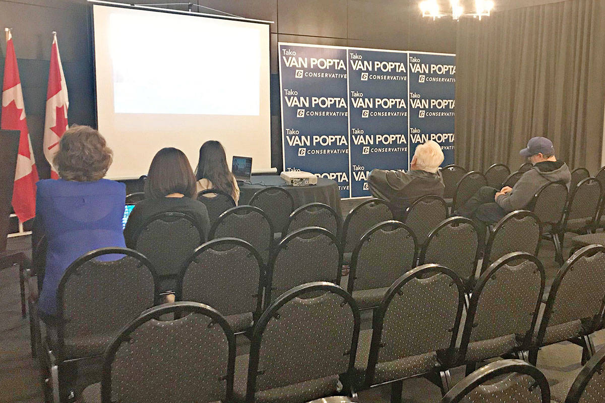 Canadians, including supporters of Langley-Aldergrove candidate Tako Van Popta, are glued to media awaiting election results. (Matthew Claxton/Langley Advance Times)