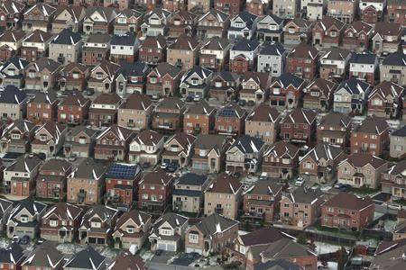 Aerial view of houses in Oshawa, Ont., seen from a Canadian forces Hercules on Saturday, Nov. 11, 2017. The federal election results mean potential new barriers for foreign real estate investors as well as some help for first time buyer, but not the more significant changes that opposition parties had promised. (THE CANADIAN PRESS/Lars Hagberg)