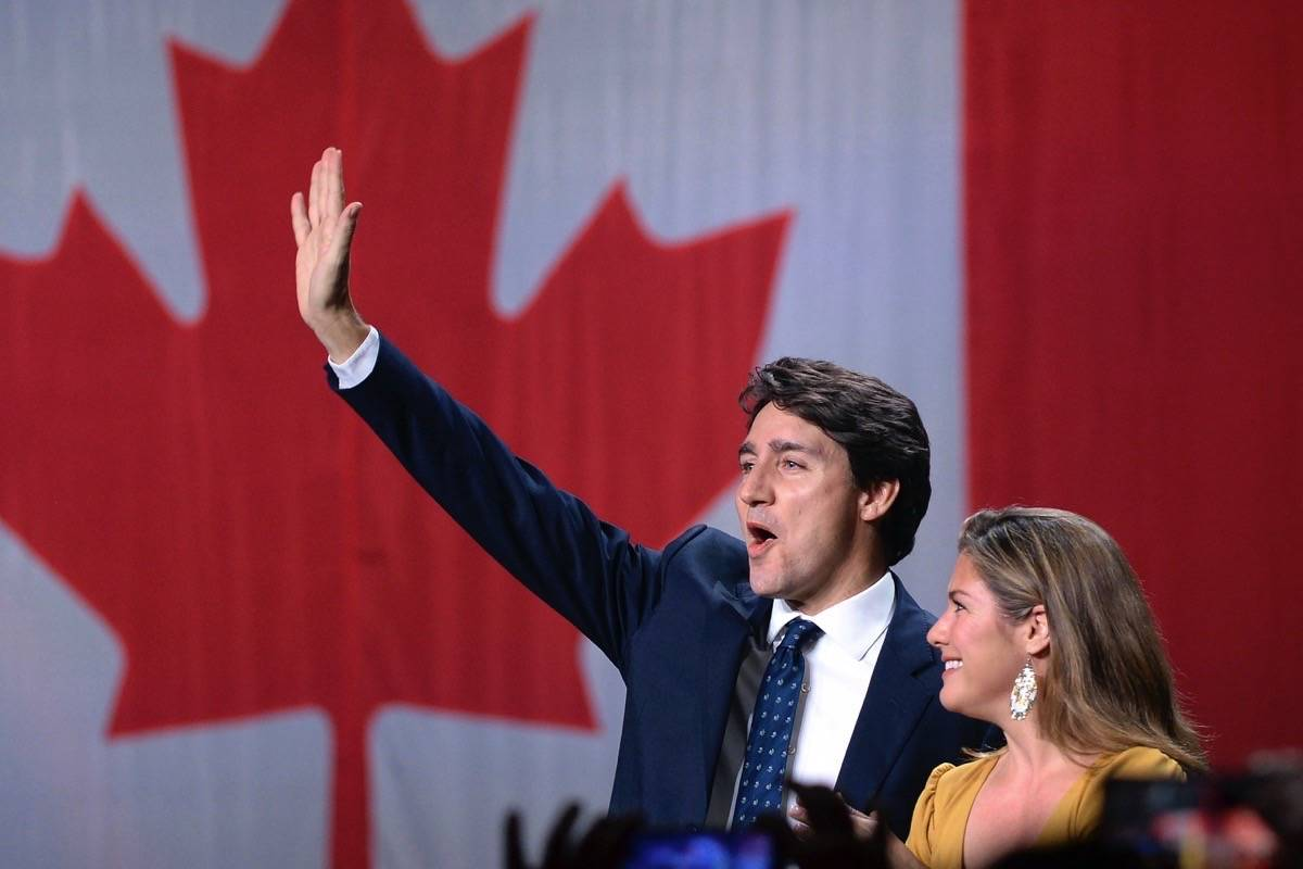 Liberal leader Justin Trudeau and wife Sophie Gregoire Trudeau wave as they go on stage at Liberal election headquarters in Montreal, Monday, Oct. 21, 2019. (Ryan Remiorz/The Canadian Press)