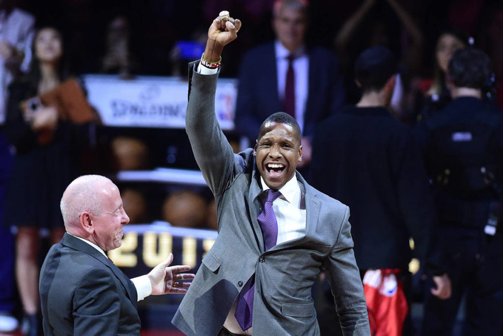 The Toronto Raptors president Masai Ujiri receives his 2019 NBA championship ring from Larry Tanenbaum, chairman of Maple Leaf Sports & Entertainment, before playing the New Orleans Pelicans in Toronto on Tuesday Oct. 22, 2019. THE CANADIAN PRESS/Frank Gunn