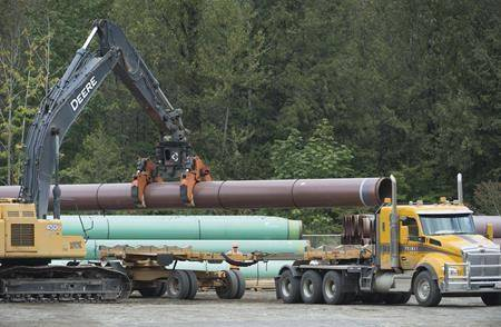 FILE - Pipeline pipes are seen at a Trans Mountain facility near Hope, B.C., Thurs., Aug. 22, 2019. A newly re-elected Prime Minister Justin Trudeau said on Wed., Oct. 23, 2019 that he wants to build the Trans Mountain pipeline expansion quickly. (Jonathan Hayward / The Canadian Press)