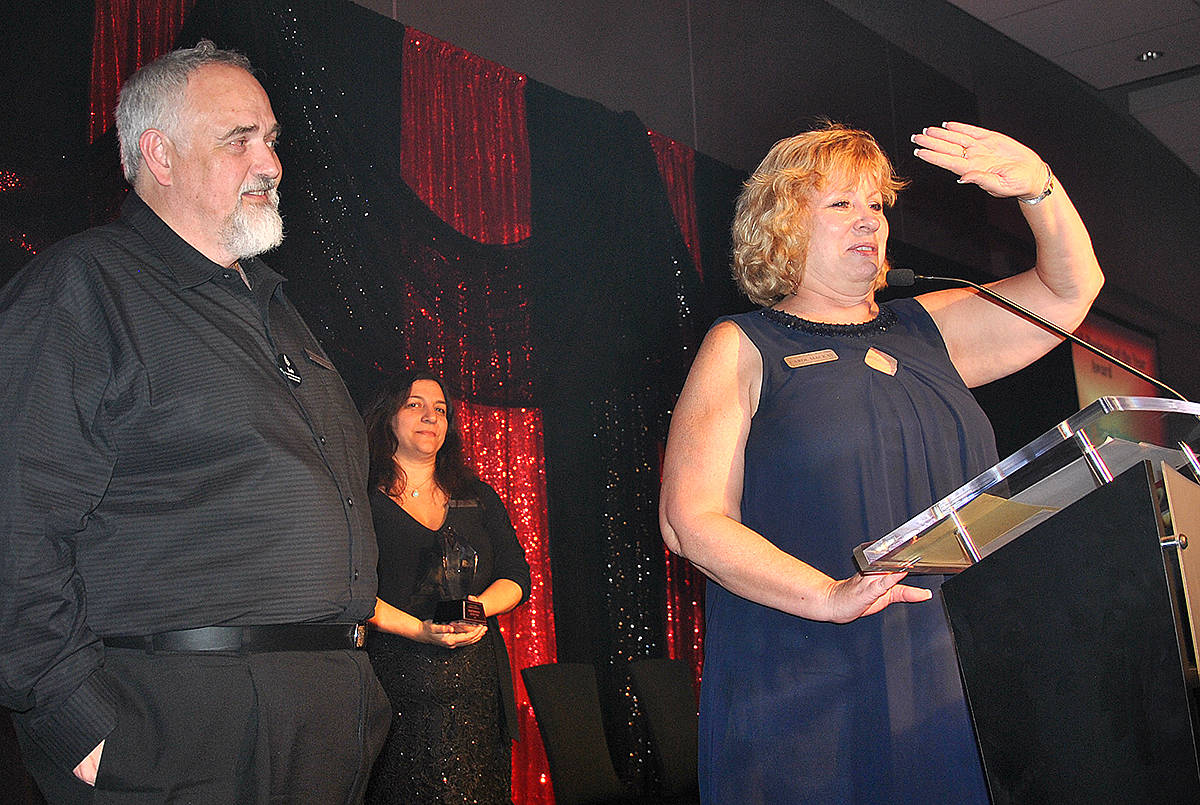 Carol MacKay and Rob Houston, of Travel Professionals International Langley, accepted an award during the Greater Langley Chamber of Commerce 23rd annual Business Excellence Awards at the Cascades Casino on Thursday, Oct. 24. (Roxanne Hooper/Langley Advance Times)