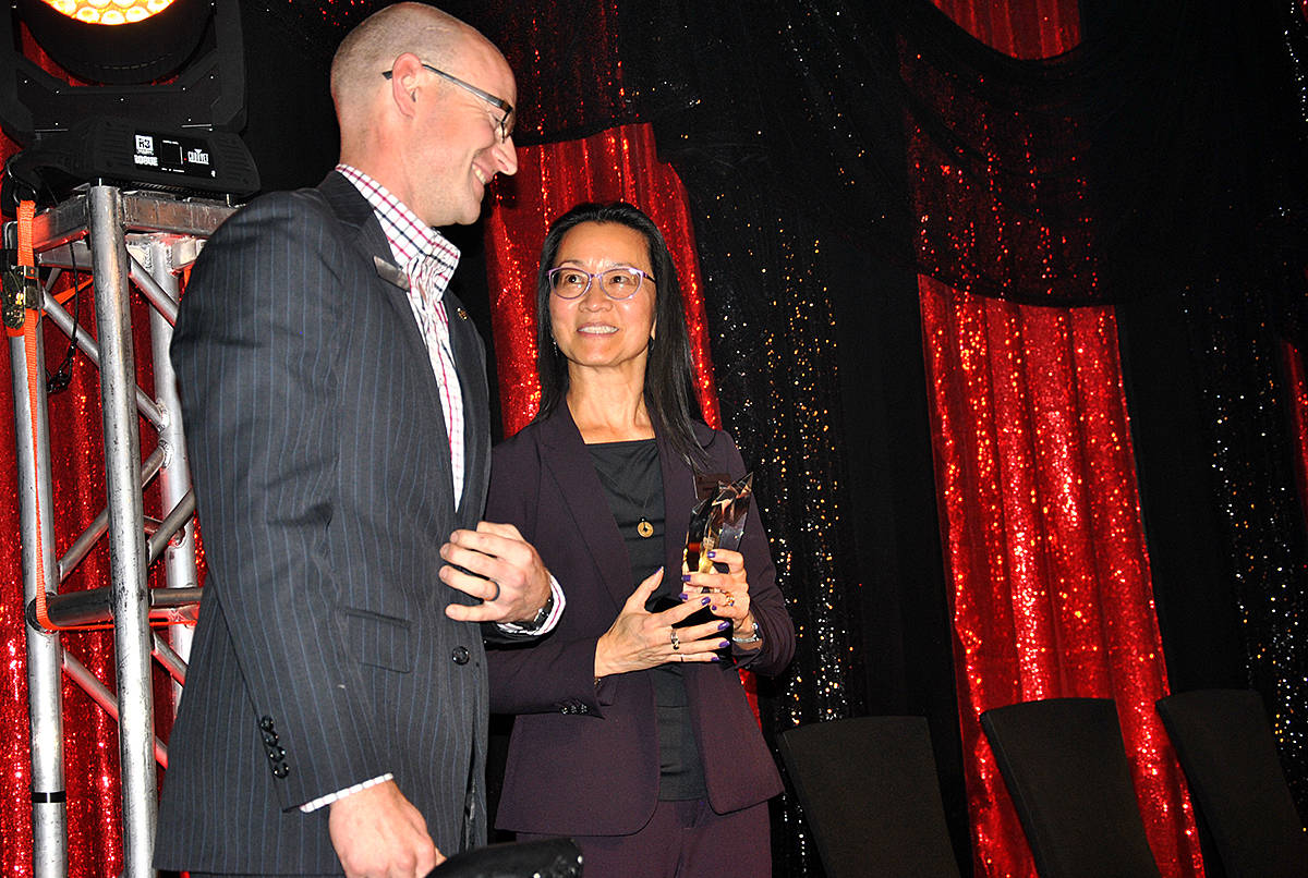 CFP Travis Strain accepted an award during the Greater Langley Chamber of Commerce 23rd annual Business Excellence Awards at the Cascades Casino on Thursday, Oct. 24. (Roxanne Hooper/Langley Advance Times)