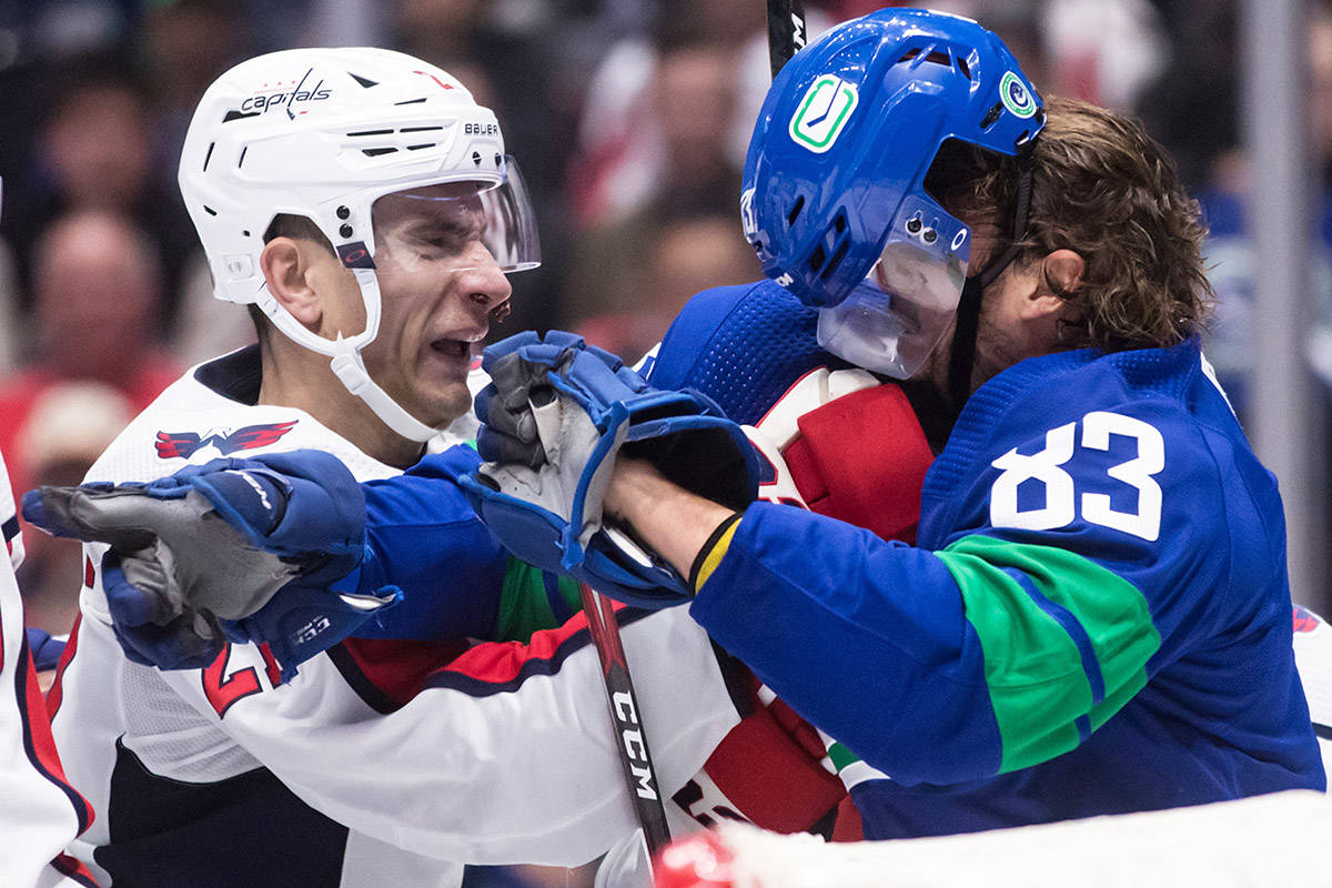Washington Capitals' Garnet Hathaway, left, and Vancouver Canucks' Jay Beagle get into a scuffle after the whistle during the second period of an NHL hockey game in Vancouver, on Friday October 25, 2019. THE CANADIAN PRESS/Darryl Dyck