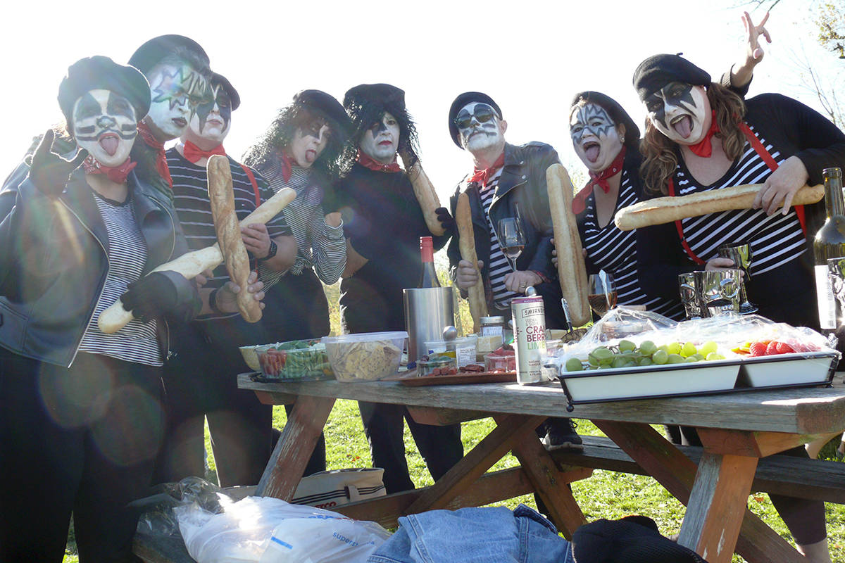 French KISS, get it? One of many high-concept teams who competed in the annual grape stomp for charity at the Township 7 winery in Langley. (Dan Ferguson/Langley Advance times)