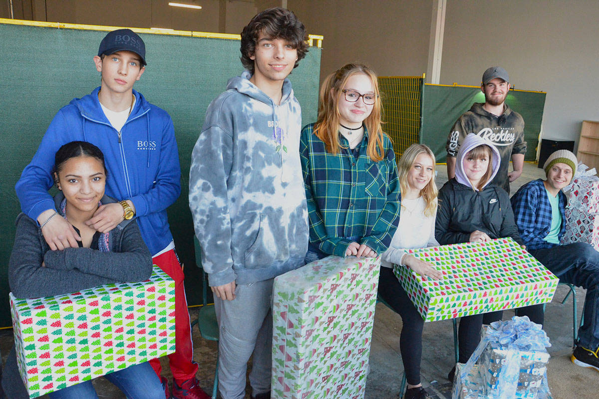 Kiara Nickel, Austin Wideman, Anthony Wideman, Sylvia Sciczina, Trinity Nyara, KC Mcmahon, Jeremie Mailhot, and Brody Schale helped make Christmas for disadvantaged families in this community. The Vanguard Secondary students did the heavy lifting to help set up the Langley Christmas Bureau. (Heather Colpitts/Langley Advance Times)